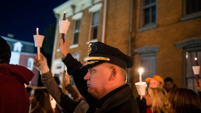 York City Police Chief Troy Bankert holds a lit candle on March 23, 2018, at a neighborhood-organized vigil for Ivan Flanscha and Zachary Anthony, two York City firefighters who died in a building collapse nearby. Assistant Chief Greg Altland and firefighter Erik Swanson sustained injuries in the same collapse.