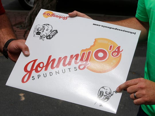 The logo for Johnny O's Spudnuts store, which will