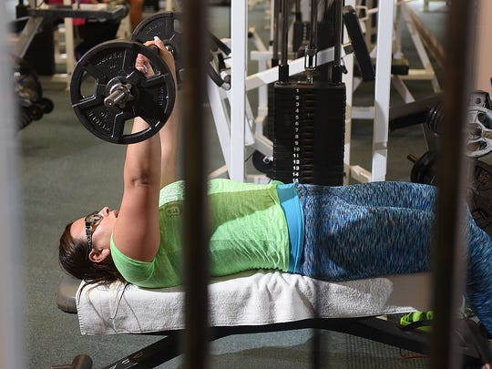 Maria Adame works out on Wednesday at the city of Bloomfield's Fitness Center.