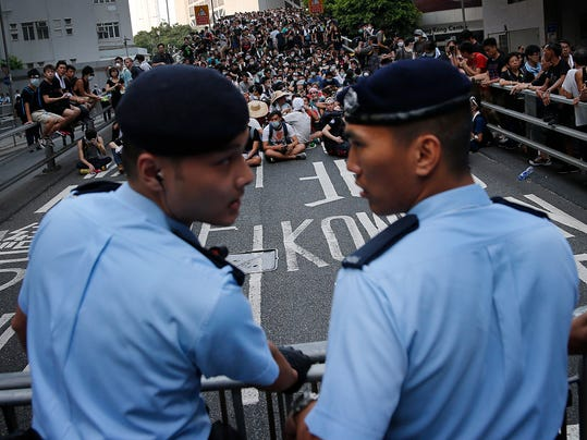 Police Protest Tactics Police Ease Tactics in Hong