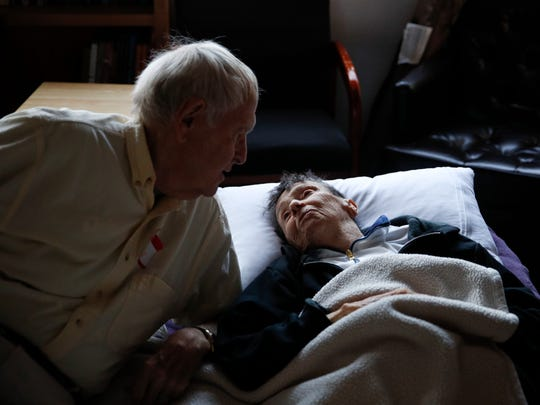FILE - In this Oct. 15, 2017 file photo, wildfire evacuees Beatrice Thomas, 85, right, chats with her husband, Al, 85, at First United Methodist Church that doubles as an evacuation shelter in Santa Rosa, Calif. The vast majority of those who died in the Northern California wildfires were in their 70s and 80s including several couples who died together. Many could not move fast enough to escape the speeding flames. Some likely never heard the frantic calls of friends or honking of neighbors' cars, possibly their only warnings of danger. (AP Photo/Jae C. Hong, File)