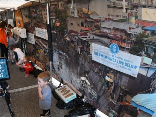 Compassion  Experience, a traveling mobile interactive exhibit by Compassion International, a Christian ministry that works in poor nations all over the world. The experience brings attention to the needs of children in underdeveloped countries with displays, audio, and detailed replicas of living conditions in the Philippines and the Dominican Republic.  They were set up at the corner of the Melbourne Square Mall parking lot  where JC Penney is located from Feb. 2-5.