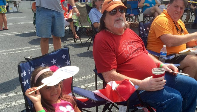 Aaliyah Engle and her grandfather, Pat Engle listen to the music at the Shenandoah Valley Blues and Brews Festival.