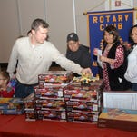 The annual Doll & Toy Distribution sponsored by the Rotary Club of Alexandria and The Town Talk. The even was held Saturday, Dec. 20, 2014 at Alexandria Convention Hall in downtown Alexandria.