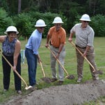 Salisbury City Council members, from left, Laura Mitchell, Jake Day, Jack Heath and Tim Spies, break ground for the new Salisbury Skatepark on Wednesday.