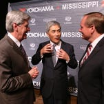 In this April 29, 2013, file photo, Gov. Phil Bryant, left, Yokohama Chief Executive Officer Hikomitsu Noii and Mississippi State University President Mark Keenum talk after the announcement of the Yokohama production facility in West Point.
