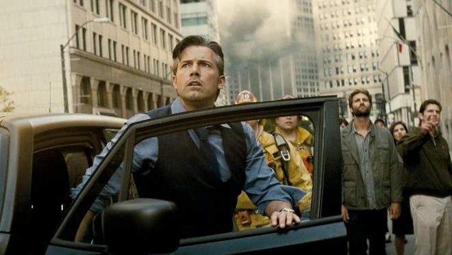 Ben Affleck, wearing the identity of Batman's alter ego, Bruce Wayne, films a suspenseful scene in downtown Detroit.