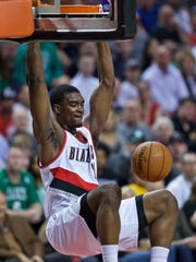 Portland Trail Blazers forward Noah Vonleh dunks against the Boston Celtics during the first half of an NBA basketball game in Portland, Ore., Thursday, March 31, 2016.
