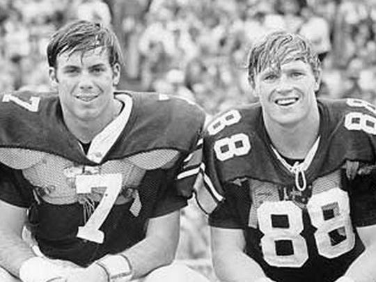 Auburn All-American Terry Beasley, sitting beside Heisman Trophy winner Pat Sullivan, is now bed ridden from brain injuries.
