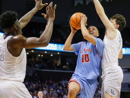 Monty Johal, of Glendale, puts up a shot during the