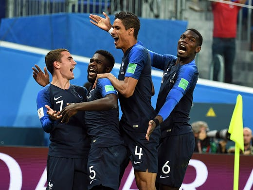 France players celebrate a goal by defender Samuel