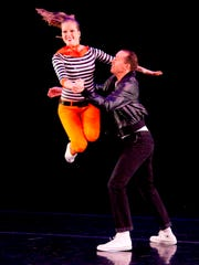 Becky Lindstone flies through the air with the help of Jared Hancock in this animated piece, a part of BYU Ballroom Dance Company's production of Capture of Magic.