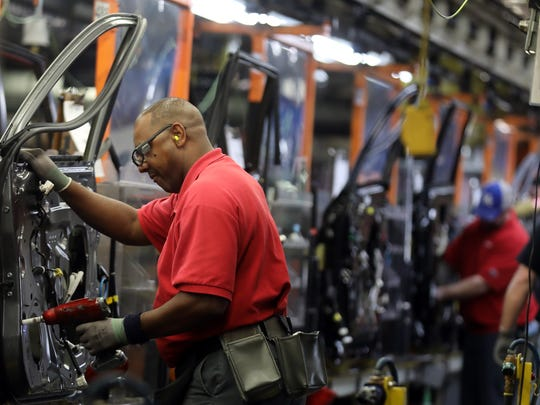 Employees work on the assembly line at Nissan's Smyrna plant Feb. 26, 2018.