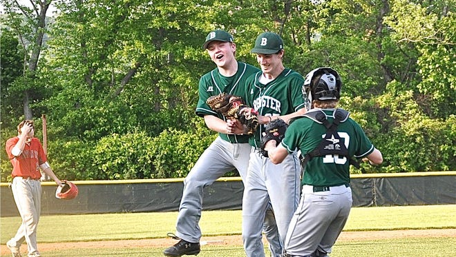 Third baseman Ryan Wynne and catcher Tim Holler mob Devin O'Connor after his complete-game, shutout win over Tappan Zee in the Class A seminfinals.