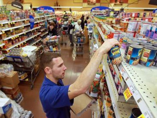 Kroger worker stocking shelf