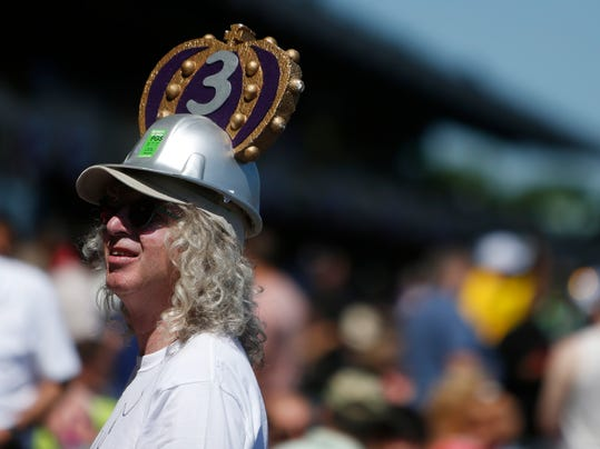 A horse racing fan wears a homemade crown before the start of racing at Belmont Park in Elmont, New York, on Saturday, June 7, 2014, in New York. The crown is in recognition of Triple Crown favorite California Chrome. (AP Photo/Jason DeCrow)