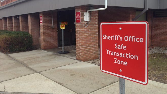"""A sign designates the area """"Sheriff's Office Safe Transaction Zone,"""" which is under recorded video surveillance and is monitored constantly by sheriff's personnel."""