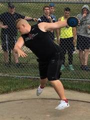 Paxton Titus of Livingston Christian swept the discus