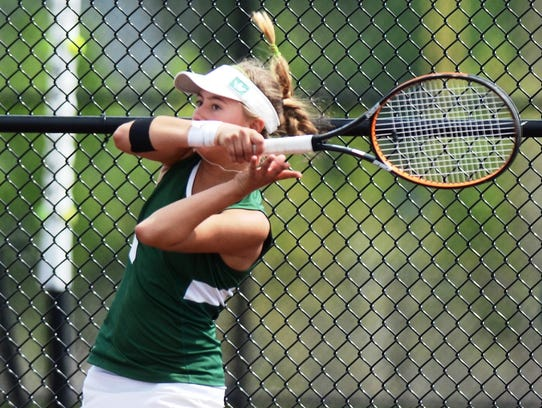 Novi's No. 3 singles player Jessica Lypka hits the