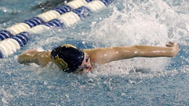 Molly Craig of Notre Dame swims to a third-place overall time in the 200-yard individual medley Friday at the state championship meet at Ithaca College.