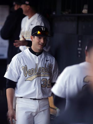 Vanderbilt's Kyle Smith talks to a teammate in the dugout during their game against UIC at Vanderbilt Friday February 26, 2016.