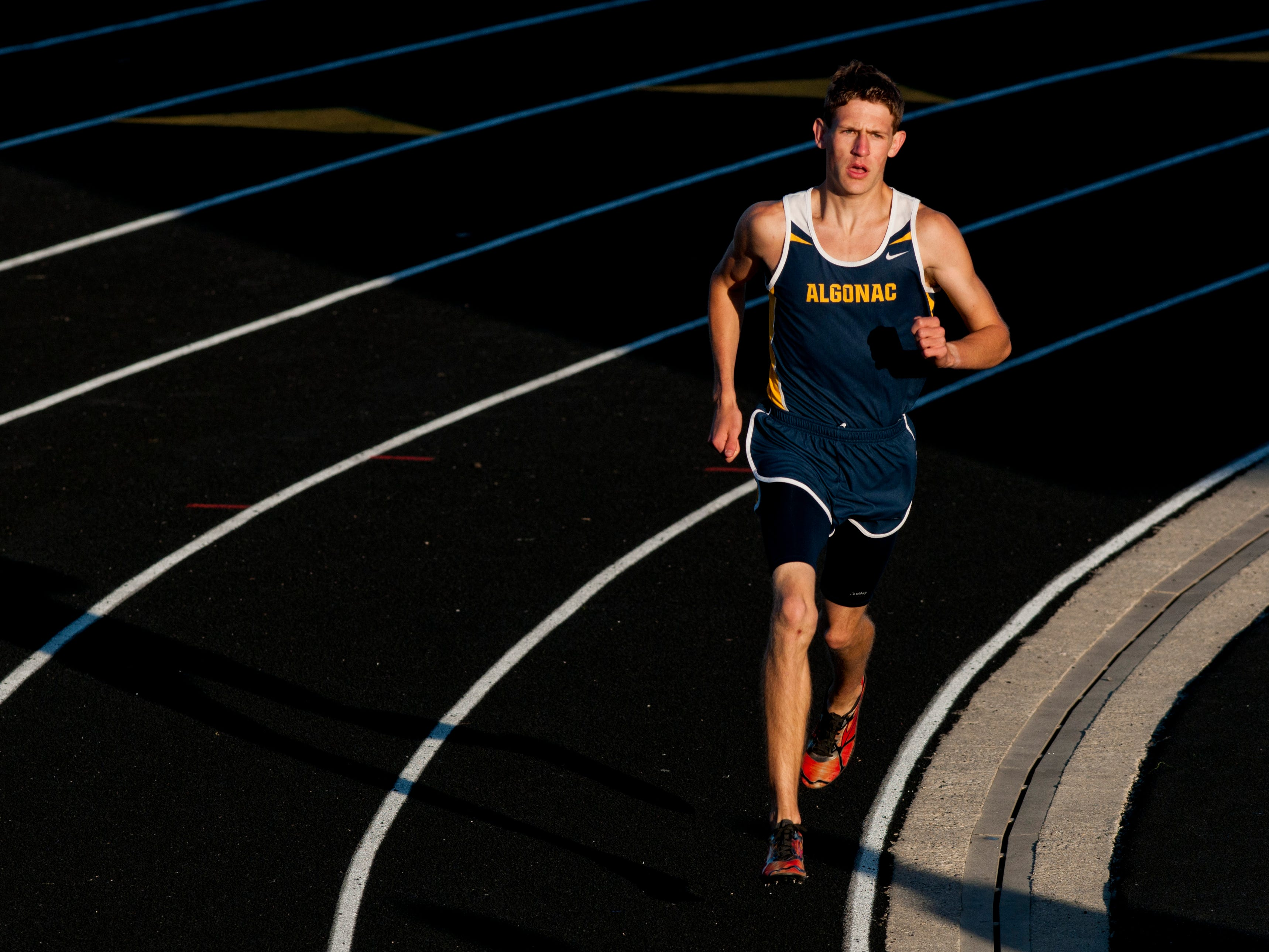 Algonac senior Morgan Beadlescomb competes in the mile run during the Meet of Champions Friday, May 22, 2015 at Marysville High School.