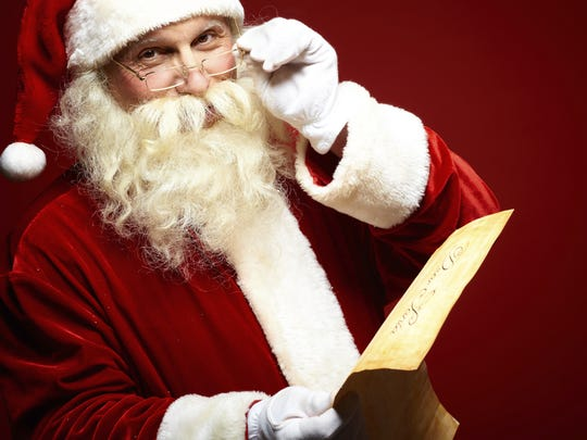 Santa Claus checks over his list.