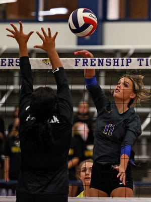 Frenship's Gracie Harrison (11) hits the ball over the net during a District 2-6A match Oct. 6 against Odessa Permian at the Tiger Pit in Wolfforth.