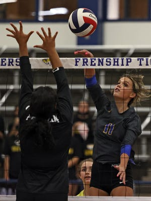 Frenship's Gracie Harrison (11) hits the ball over the net during a District 2-6A match earlier in the season against Odessa Permian at the Tiger Pit in Wolfforth.
