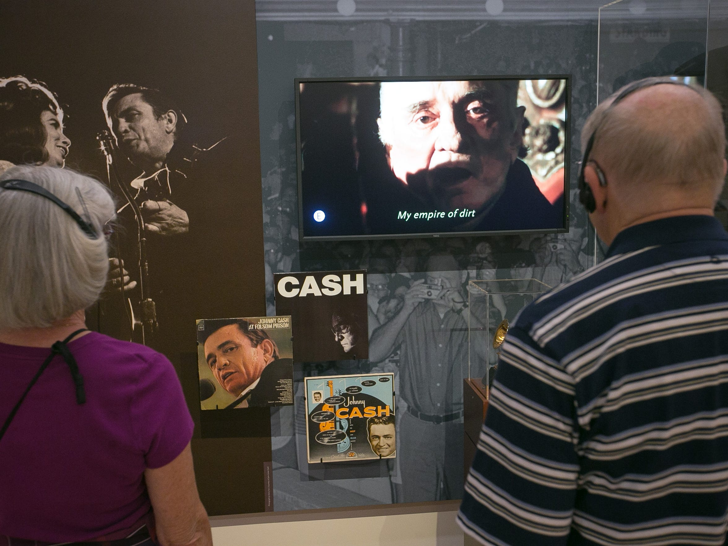 Visitors look at the new Carter Family and Johnny Cash