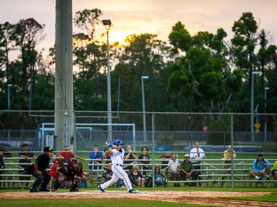 Barron Collier junior Dylan Doria swings during the