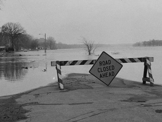 Floodwaters from the Mississippi River cover Fifth Avenue North — just below St. Cloud Cathedral High School — in April 1965.