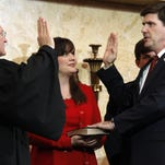 In this 2012 photo, State Auditor Stacey Pickering is sworn in as his wife, Whitney Pickering, looks on.