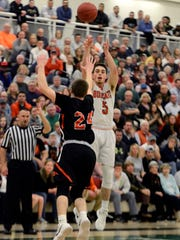 Northeastern's Antonio Rizzuto shoots for three while