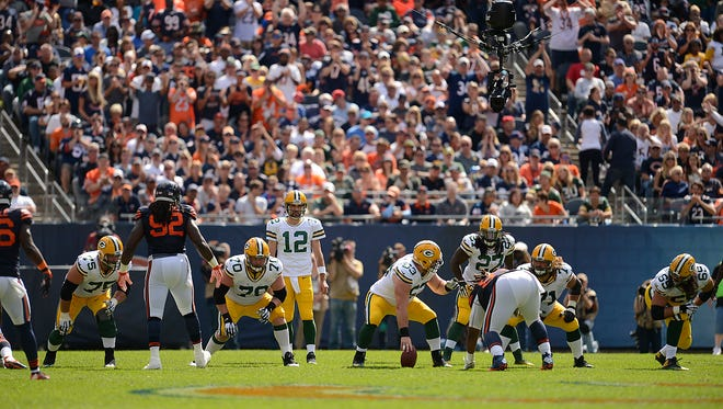 Green Bay Packers quarterback Aaron Rodgers waits to take the snap during their Week 1 game against the Chicago Bears at Soldier Field in Chicago.