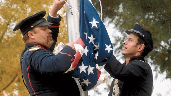 Wade Pinkston and William Grizzell switch the Mexican flag for the U.S. flag of 1854 at a recent El Tratado de La Mesilla re-enactment on the Mesilla Plaza/. The event, at 2 p.m. Saturday, will mark the official recognition of the Gadsden Purchase, that transferred what was once Mexican territory to the United States.