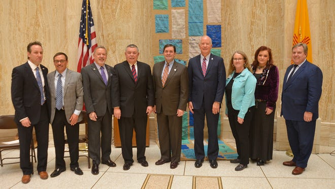 Pictured at the roundhouse are, from left, Home Builders Association of Central New Mexico President Mike Feitz, Home Builders Association of Central New Mexico Executive Vice President John Garcia, Apartment Association of New Mexico President Bobby Griffith, USDA Rural Development State Director Art Garcia, RANM CEO Steven Anaya, Mortgage Finance Authority Executive Director Jay Czar, RANM President Connie Hettinga, New Mexico Mortgage Lenders Association President Suzie Nance, and Jack Thompson of the New Mexico Mortgage Lenders Association.