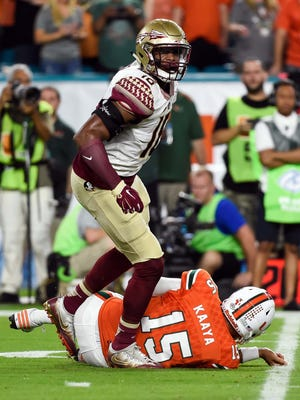Oct 8, 2016; Miami Gardens, FL, USA; Miami Hurricanes quarterback Brad Kaaya (15) is sacked by Florida State Seminoles linebacker Jacob Pugh (16) during the first half against at Hard Rock Stadium. Mandatory Credit: Steve Mitchell-USA TODAY Sports