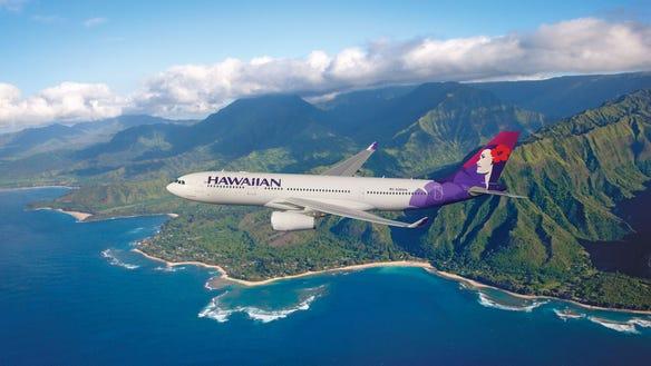 AP HAWAIIAN AIRLINES PLANE FLYING OVER HAWAII