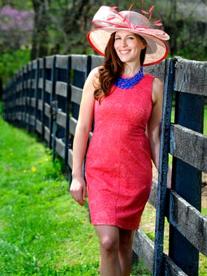Coral lace dress by Vince Camuto, $148; blue triple strand necklace, $38; tan and coral hat by Kate Landry, $78, all from Dillard's at The Mall at Green Hills.