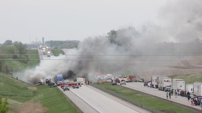 Smoke can be seen billowing from the scene of a multi-vehicle accident near milepost 214 of Interstate 80, seven miles south of Marengo, Friday afternoon, May 8. The crashes involved a tour bus, semtrailer truck and several other vehicles, according to the Iowa State Patrol. There were at least 32 injuries and multiple agencies called to assist, including an air ambulance.