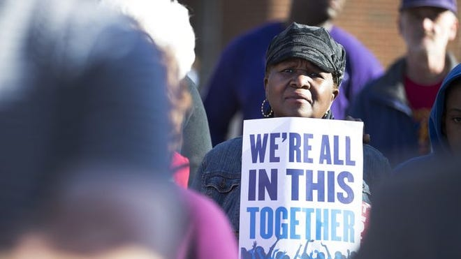 Merlean Jackson of Rochester attends a rally supporting a $15 an hour minimum wage at the University of Rochester.