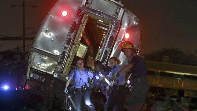 Emergency personnel work the scene of the deadly Amtrak train wreck May 12 in Philadelphia.