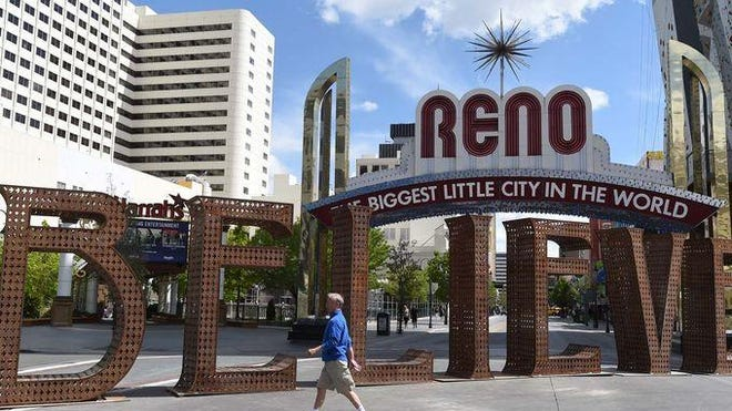 """The """"Believe"""" sculpture is pictured before the Reno Arch during the Reno Sculpture Fest in May."""