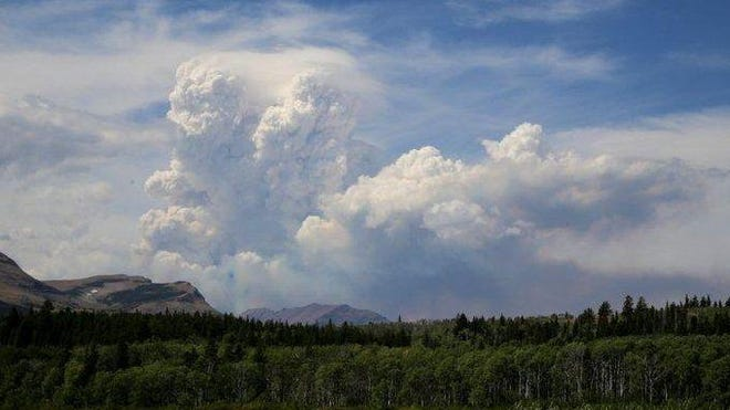 The Thompson fire in Glacier National Park, spotted Sunday, is threatening a cabin.