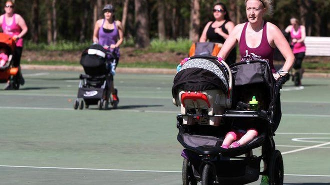 Jessica Hamel (right) runs a Jersey Stroller Moms workout as she pushes her two children.