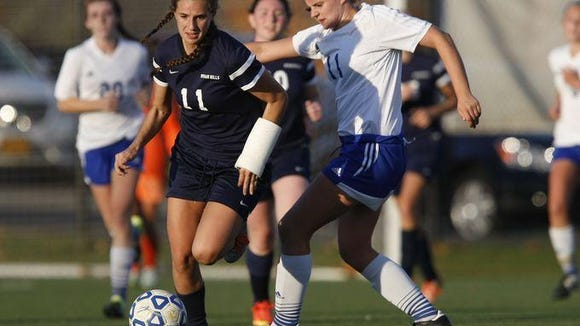 Byram Hills' Jessica Kennett (11) and Pearl River's Lauren Zimnoch (11) battle for possession during a sectional semifinal girls soccer game in Orangeburg on Oct. 29.
