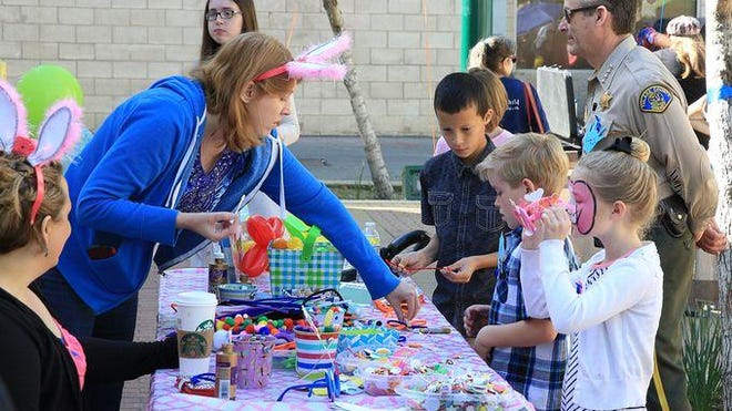 CASA of Tulare County ties blue ribbons on Main Street to help bring awareness to child abuse prevention month.