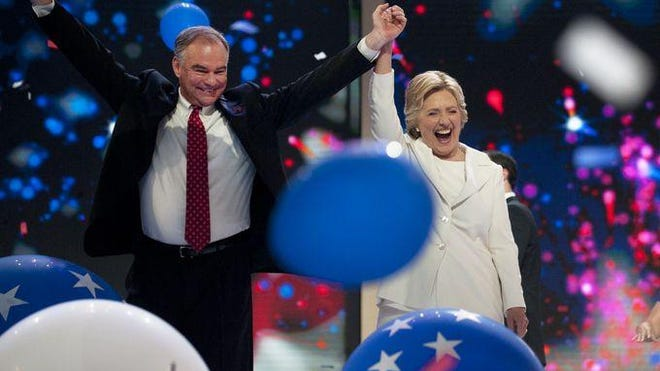 Tim Kaine and Hillary Clinton celebrate at the Democratic National Convention.