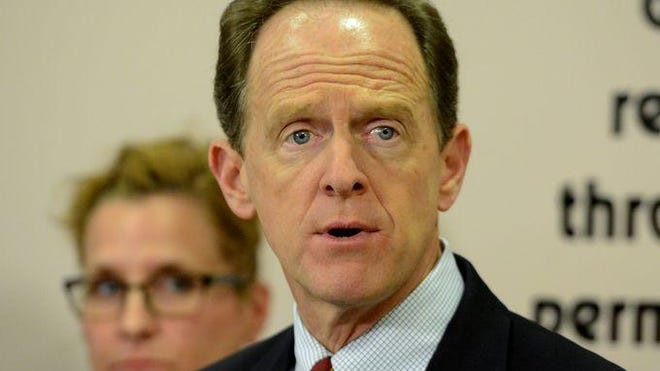 Sen. Pat Toomey, R-Pa., speaks in April at the York County SPCA. Toomey has joined other senators in co-sponsoring a bill to subject the president's trade actions to congressional approval.